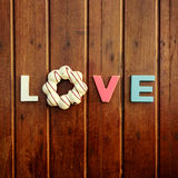 Word love on the wooden table Stock Images