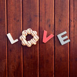 Word love on the wooden table Stock Image