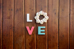 Word love on the wooden table Stock Photography