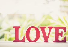 Word LOVE wooden text vintage on wood table vintage retro tone stock photography