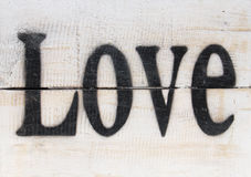 The word love on a wooden vintage background Stock Photo