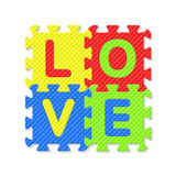 Word LOVE written with alphabet puzzle letters. Illustration Stock Photo