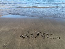 Word love written on the beach with water Royalty Free Stock Images