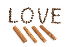 The word love written with coffee beans and cinnamon stick on whi Royalty Free Stock Photography