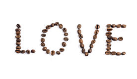 The word love written with coffee beans on white background Royalty Free Stock Photography