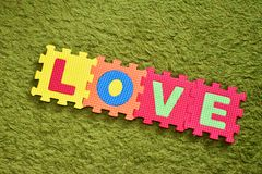 The word love written with a colorful children`s puzzle stock photos