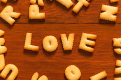 The word love written with cracker Stock Images