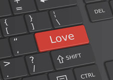 The word Love written on the keyboard. The word Love written on a red key from the keyboard Royalty Free Stock Photo