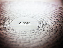 The word love written on a lined piece of school paper Stock Photo