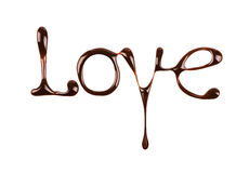 The word Love written by liquid chocolate on white Stock Photos