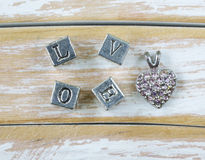Word LOVE written in metal letters Stock Photos