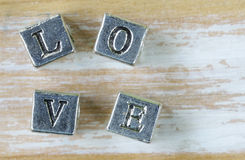 Word LOVE written in metal letters Royalty Free Stock Photography