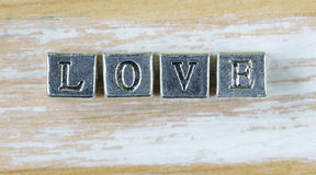 Word LOVE written in metal letters Royalty Free Stock Photo