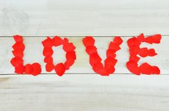 Word love rose petals Stock Photos