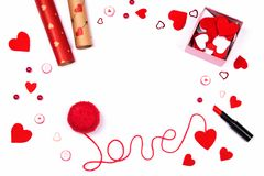 Word love written with red wool thread and cute accessories. royalty free stock photos