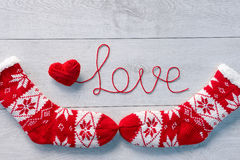 Word love written of red wool yarn and warm socks Royalty Free Stock Photography