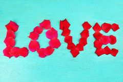 Word love rose petals Royalty Free Stock Images