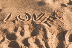Word love written on sand Royalty Free Stock Photos