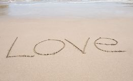 Word love written in the sand on tropical beach Royalty Free Stock Photography