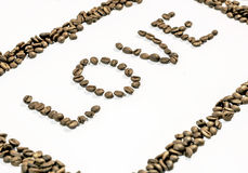 The word love written from side with coffee beans and frame made of coffee Royalty Free Stock Photo