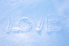 Word LOVE written on the snow Stock Image