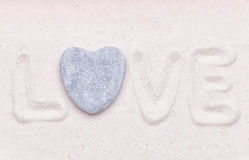 The word love is written in the white sand Royalty Free Stock Image