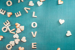 The word love written with wooden letters on a blue background. Royalty Free Stock Images