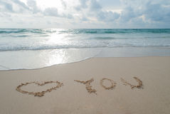 The Word love you Written in the Sand on a Beach  at Phuket isla Stock Images