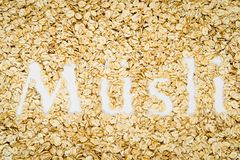 Word Müsli written in oat flakes stock images