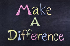 Word make a difference. Handwritten on blackboard Stock Images