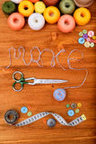 Word make with sewing tools and accesories on wooden background Stock Photography