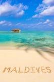 Word Maldives on beach Stock Photo