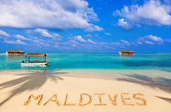Word Maldives on beach Royalty Free Stock Photos