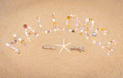 Travel to Mallorca, summer beach holiday at Spain, Balearic Islands. Word Mallorca writing with seashells on sandy beach and maritime decoration, high angle view Stock Photography