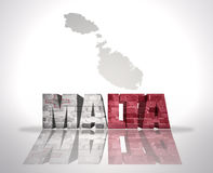 Word Malta on a map background Stock Photography
