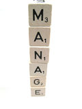 The word manage spelled out. With wooden blocks royalty free stock images