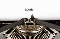 The word `Mania` from a typewriter on white Royalty Free Stock Images