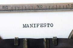 Word manifesto typed on typewriter Stock Image
