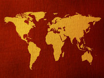 Word map backgroiund. World map over a red tissue background stock photography