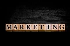 Word MARKETING isolated on black background Stock Image