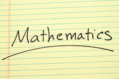 Mathematics On A Yellow Legal Pad. The word `Mathematics` underlined on a yellow legal pad Stock Photos