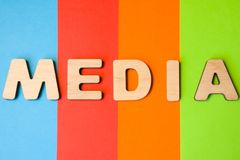 Word Media composed of 3D letters is in background of 4 colors: blue, red, orange and green. Concept of media as tools used to sto stock image