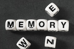 Word memory on toy cubes. Word memory on white toy cubes Royalty Free Stock Images
