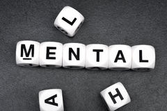 Word mental on toy cubes Stock Photo