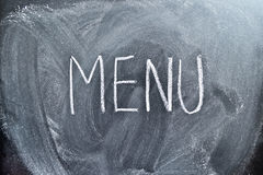 The word Menu on a blackboard Stock Photos
