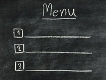 The word menu written on blackboard Stock Images