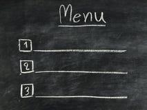 The word menu written on blackboard Stock Images