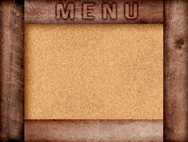 Word menu written, burned lettering on wooden brown frame with copy space on pin board background Stock Photo