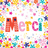 Word Merci Thanks in French typography unique lettering decorative text floral card Stock Photos