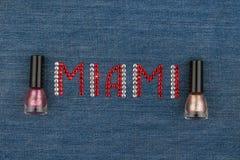 Word Miami, made of rhinestones, encrusted on denim. World Fashion. Stock Photos